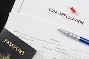 Temporary Resident Visa visitor application and passport for Canada