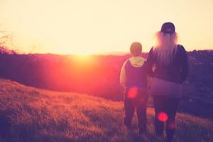 Family looking at a sunset dreaming for Permanent Residence in Canada